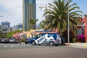 mauzy service van driving to furnace repair in san diego ca