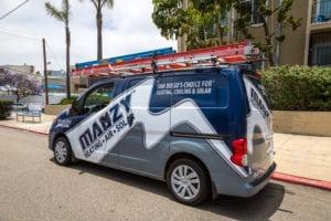 mauzy van driving to heating repair in san diego ca