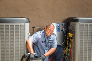 mauzy technician doing ac installation in san diego ca