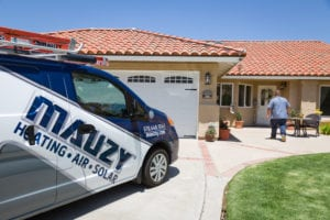 mauzy tech at homeowners house to discuss hvac services in san diego ca