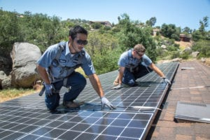 mauzy solar technicians installing solar panels on roof of house in san diego ca
