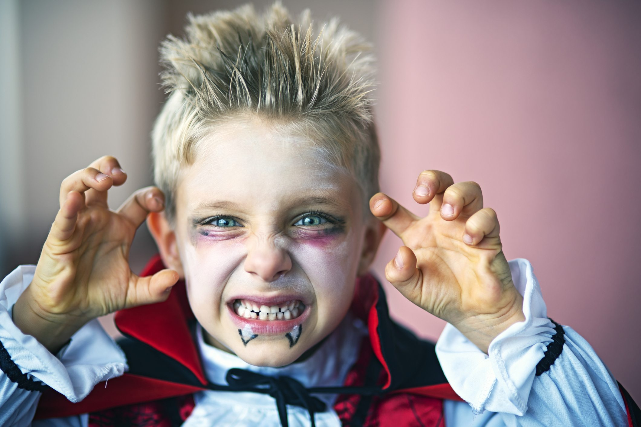 boy dressed up as a vampire for halloween