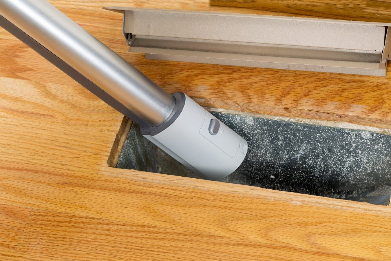 vacuuming heating and air conditioning vent