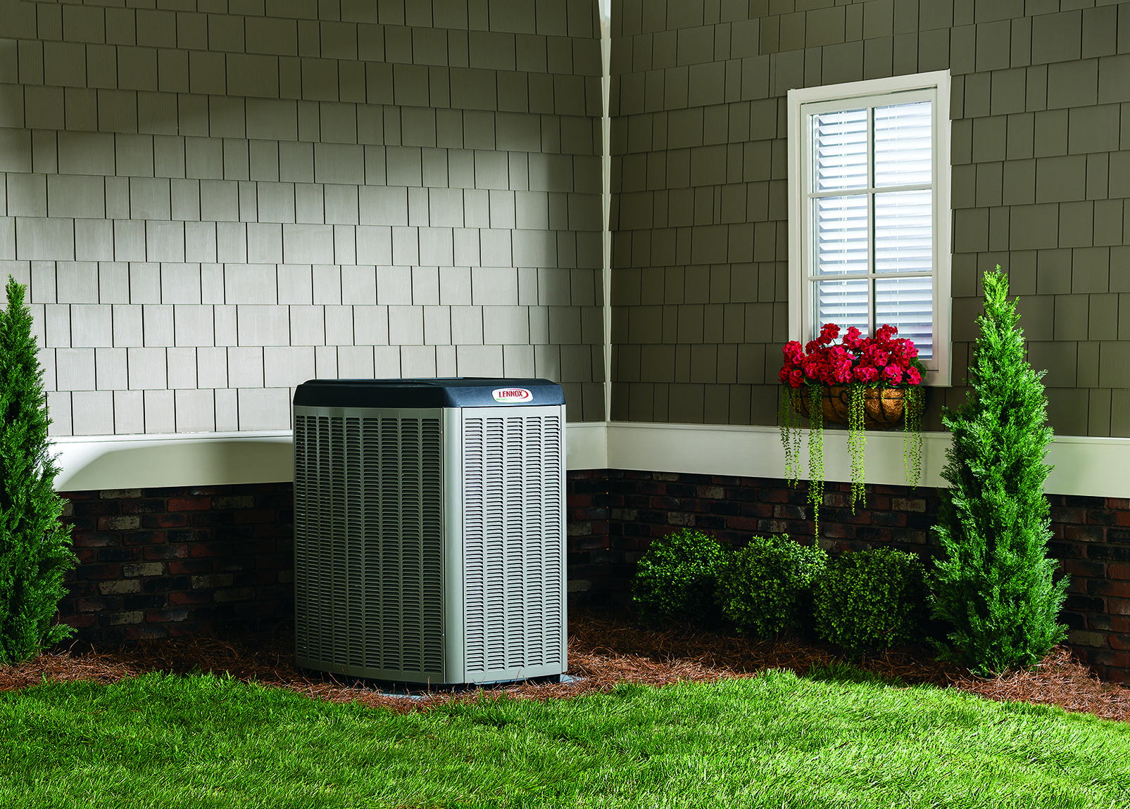 Lennox air conditioning unit in backyard