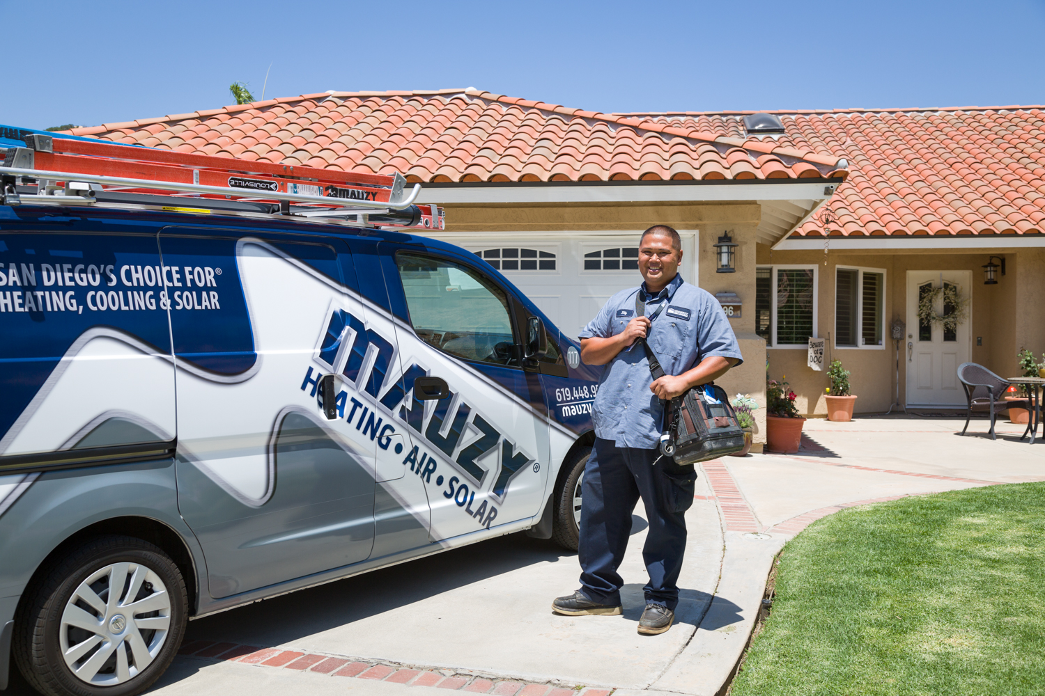mauzy hvac technician on a service call in san diego